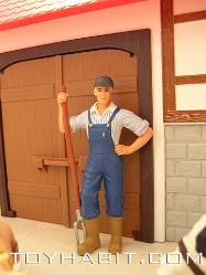 FARM BOY IN OVERALLS, WITH A PITCH FORK, STANDING