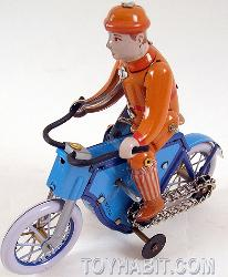 MAN ON A MOTORCYCLE- TIN WIND UP TOY-SCHYLLING